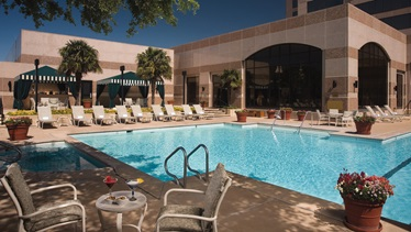 Outdoor lounge and pool San Antonio Hotel
