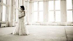 Bride posing in ballroom