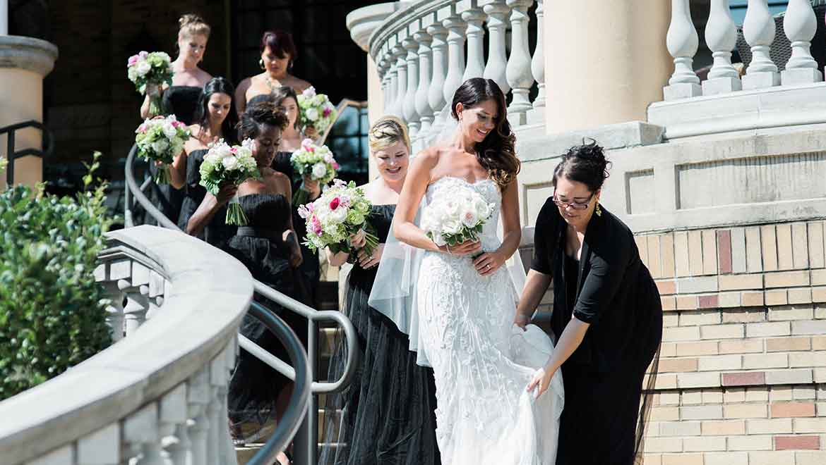 Bridal party walks down the outdoor patio stairs
