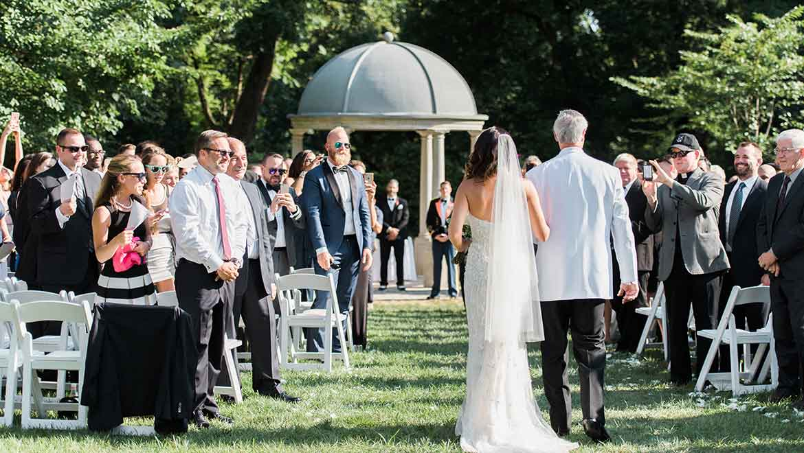 Father walks bride down the aisle