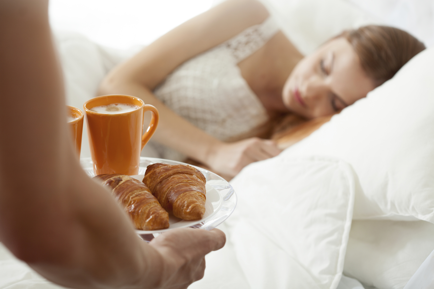 Surprise breakfast for sleeping woman