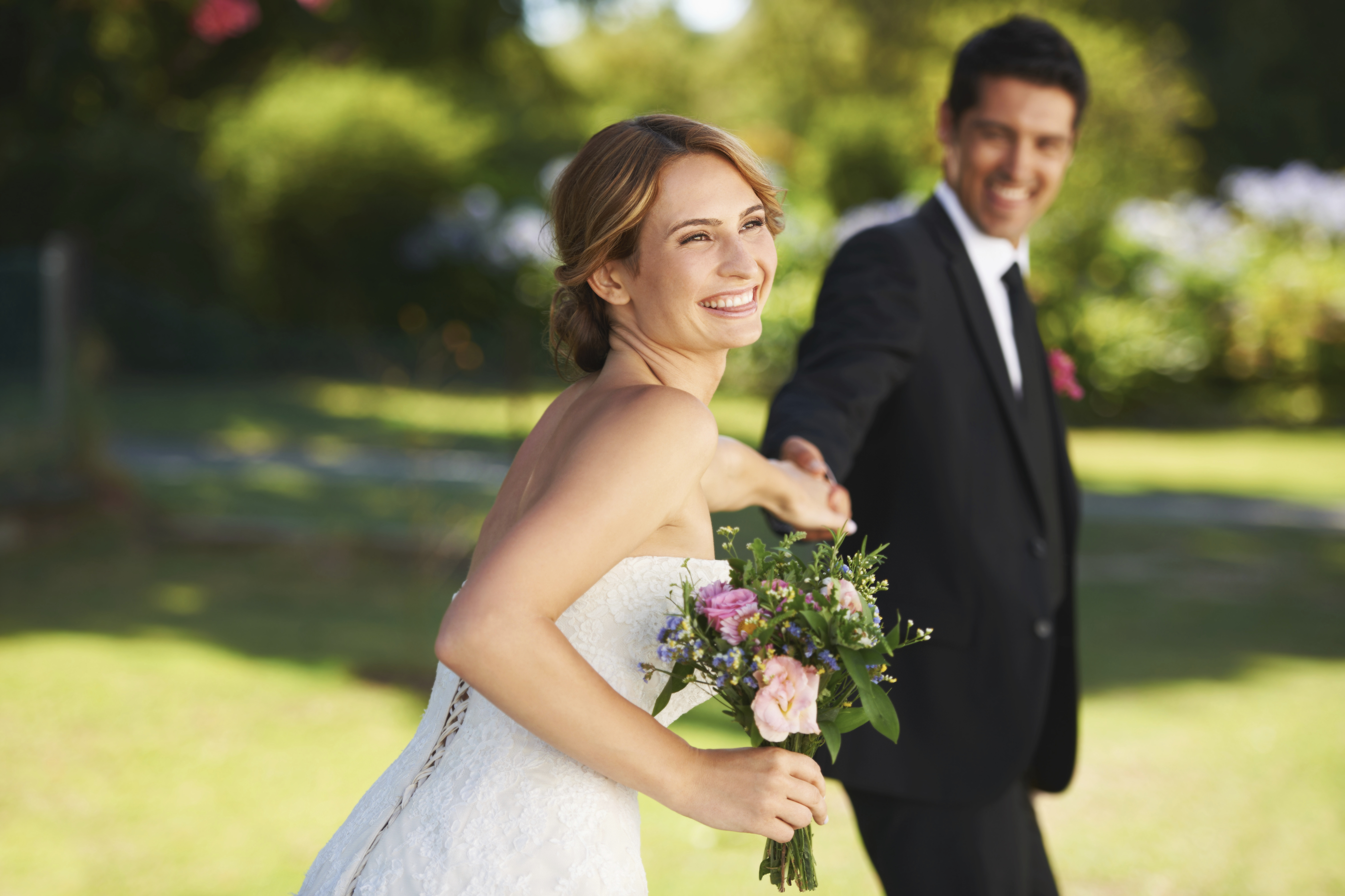 groom-pulling-bride-162493448
