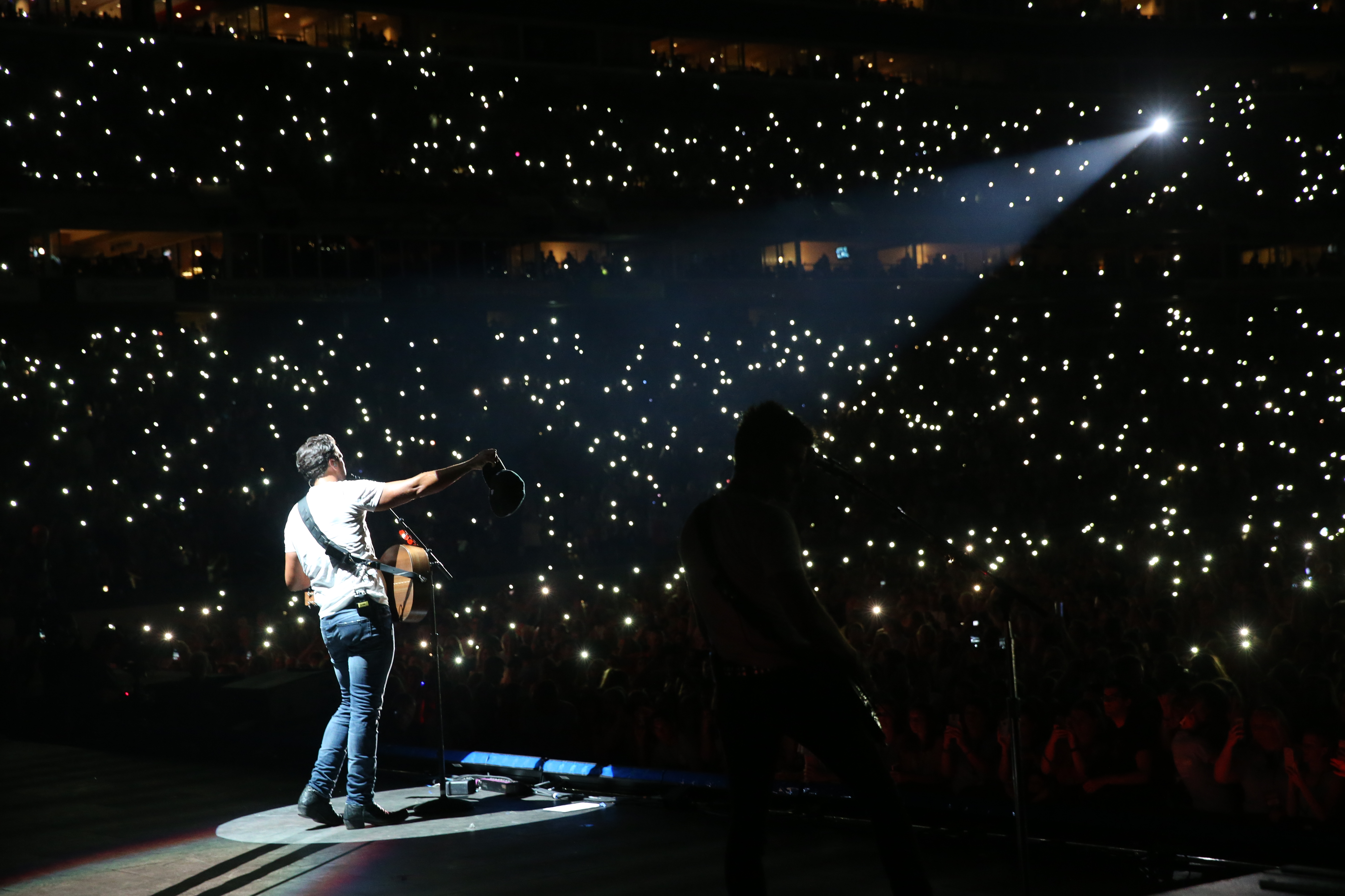 Luke Bryan singing to a large crowd at CMA Fest