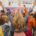 woman hands up at music festival