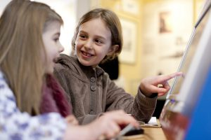 two girls playing with touch screen