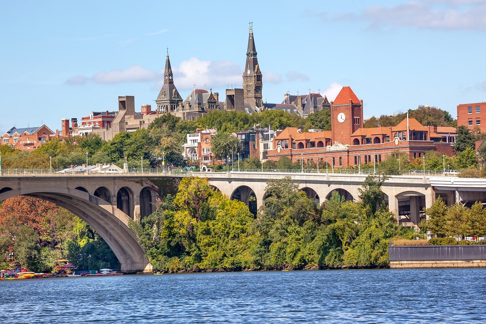 Key Bridge Potomac River Georgetown University Washington DC from Roosevelt Island.  Completed in 1923 this is the oldest bridge in Washington DC.