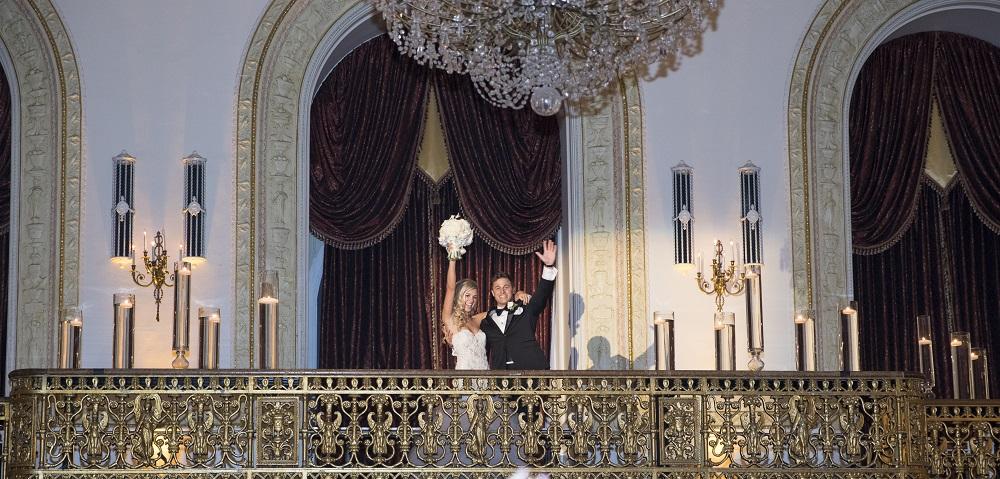Bride and groom on balcony