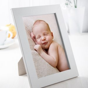White picture frame with photo of baby