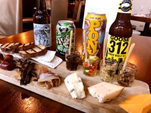Assortment of beer with cheese and snack tray