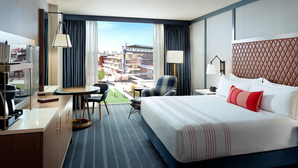 king bed hotel room with view of Braves stadium