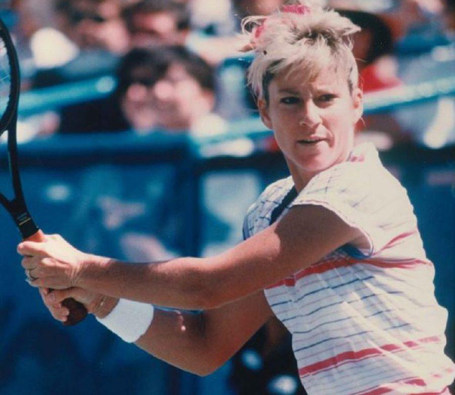 Chris Everit playing tennis