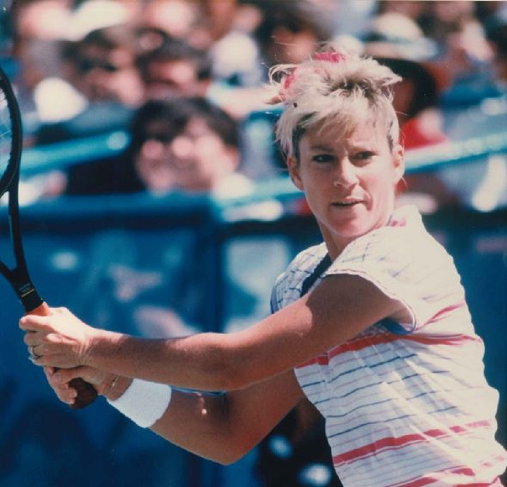 Chris Everit playing tennis