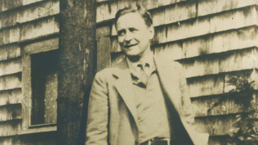 F. Scott Fitzgerald in front of building