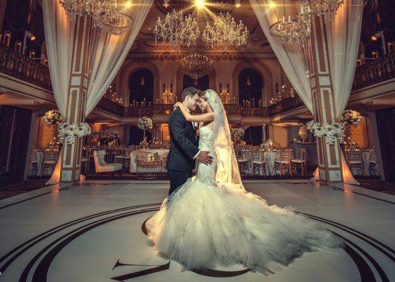 Wedding Couple dancing in ballroom