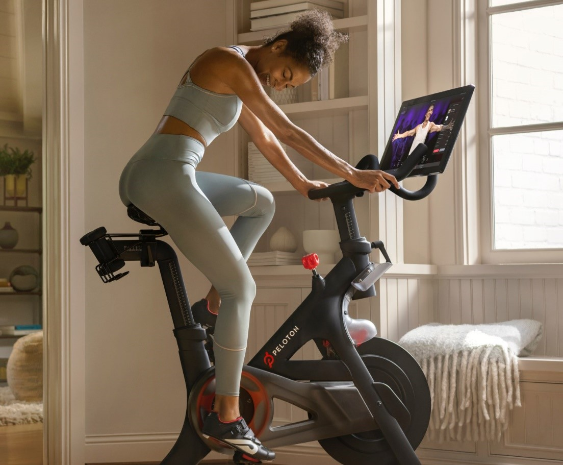 Lady using Peloton