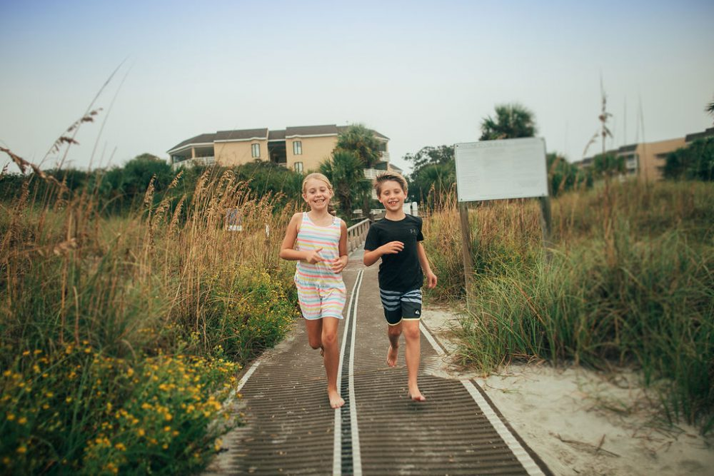 Young boy and girl walking