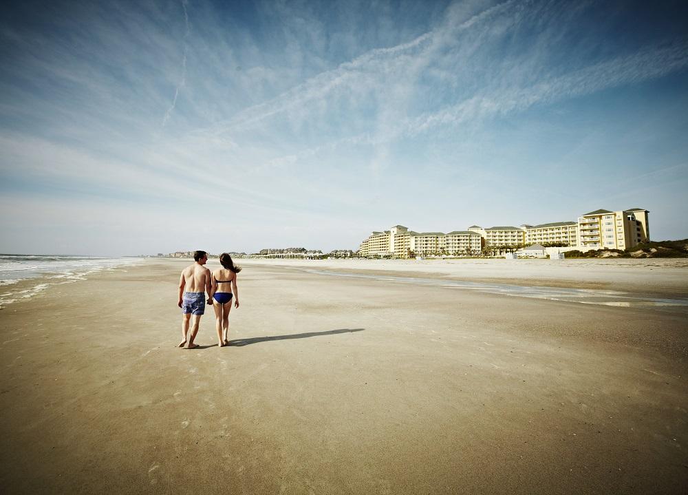 Couple walking on Amelia Island Beach