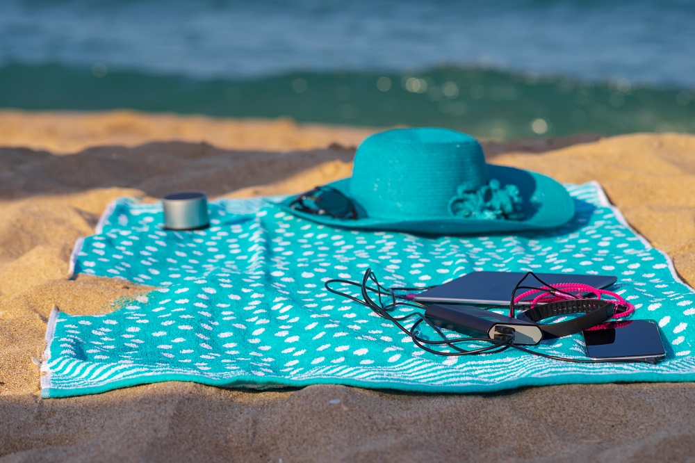 Beach towel with electronic gadgets