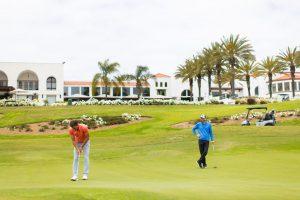 Two men playing golf at Omni La Costa