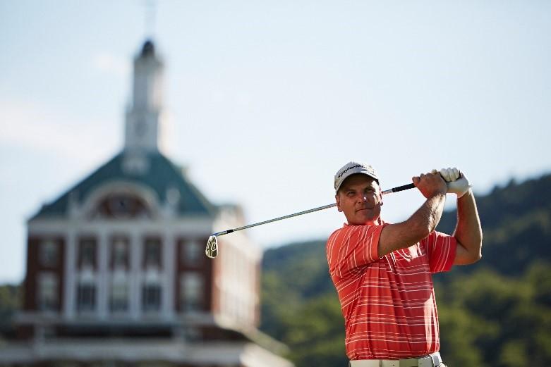 Man Practicing Golf Swing