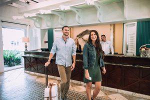Couple Checking into Omni Hilton Head Resort