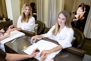 young women getting a manicure at Omni Homestead