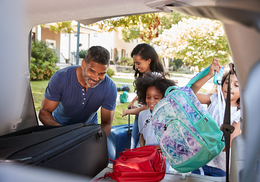 Family Packing Car For Road Trip