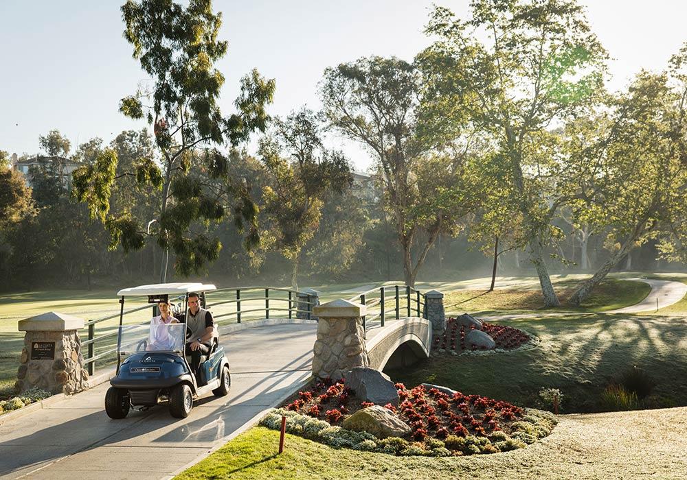 Couple golfing at Omni La Costa Resort & Spa